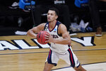 FILE - In this March 30, 2021, file photo, Gonzaga guard Jalen Suggs passes up court during the second half of an Elite 8 game against Southern California in the NCAA men's college basketball tournament in Indianapolis. Cunningham is a 6-foot-8 ballhandler with the ability to play on or off the ball. He's widely expected to be the No. 1 NBA draft pick after one year with the Cowboys. (AP Photo/Darron Cummings, File)