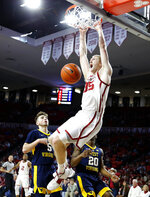 Oklahoma's Brady Manek (35) dunks the ball in front of West Virginia's Jordan McCabe (5) and Taevon Horton (20)during an NCAA college basketball game in Norman, Okla., Saturday, March 2, 2019. (Bryan Terry/The Oklahoman via AP)