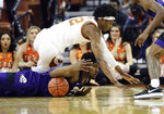 TCU guard RJ Nembhard, bottom, and Texas forward Kai Jones, top, chase a loose ball during the second half of an NCAA college basketball game in Austin, Texas, Wednesday, Feb. 19, 2020. (AP Photo/Eric Gay)