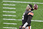 Cleveland Browns quarterback Baker Mayfield throws the game ball to a fan in the stands after the Browns defeated the Philadelphia Eagles in an NFL football game, Sunday, Nov. 22, 2020, in Cleveland. (AP Photo/Ron Schwane)