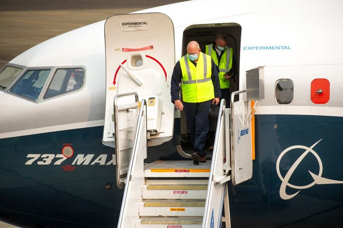 FAA chief Steve Dickson walks out of a Boeing 737 MAX, after concluding a test flight and landing at Boeing Field in Seattle, Wednesday, Sept. 30, 2020.  The Max has been grounded since March 2019, after the second crash. (Mike Siegel/The Seattle Times via AP, Pool)