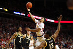 Iowa State guard Rasir Bolton, center, drives to the basket over Southern Mississippi forward Boban Jacdonmi (13) during the first half of an NCAA college basketball game, Tuesday, Nov. 19, 2019, in Ames, Iowa. (AP Photo/Charlie Neibergall)