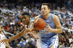 Virginia Tech guard Landers Nolley II (2) and North Carolina guard Justin Pierce (32) reach for the ball during the second half of an NCAA college basketball game at the Atlantic Coast Conference tournament in Greensboro, N.C., Tuesday, March 10, 2020. (AP Photo/Gerry Broome)