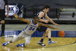 Creighton guard Denzel Mahoney (34) tries to steal the ball from Xavier forward Zach Freemantle (32) in the second half during an NCAA college basketball game on Wednesday, Dec. 23, 2020, in Omaha, Neb. (AP Photo/John Peterson)