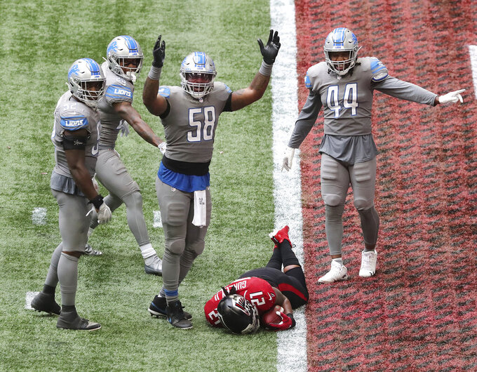 "Detroit Lions linebacker Jamie Collins (58) signals ""touchdown"" as Atlanta Falcons running back Todd Gurley tries to stop short of the end zone to control the final minutes of the clock in the fourth quarter of an NFL football game Sunday, Oct. 25, 2020, in Atlanta. (Curtis Compton/Atlanta Journal-Constitution via AP)"