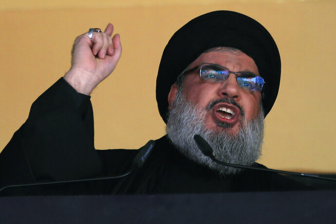 FILE - In this Oct. 24, 2015 file photo, Hezbollah leader Sheik Hassan Nasrallah addresses a crowd during the holy day of Ashoura, in a southern suburb of Beirut, Lebanon. U.S. Secretary of State Mike Pompeo's visit to Lebanon this week is expected to underscore the Trump administration's displeasure with Hezbollah's growing influence in Lebanese politics. The Iranian-backed group wields more power than ever in the country's Cabinet and parliament. (AP Photo/Hassan Ammar, File)