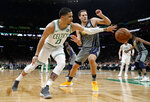Boston Celtics' Jayson Tatum (0) reaches for a loose ball in front of Indiana Pacers' Bojan Bogdanovic during the second quarter of an NBA basketball game Friday, March 29, 2019, in Boston. (AP Photo/Winslow Townson)