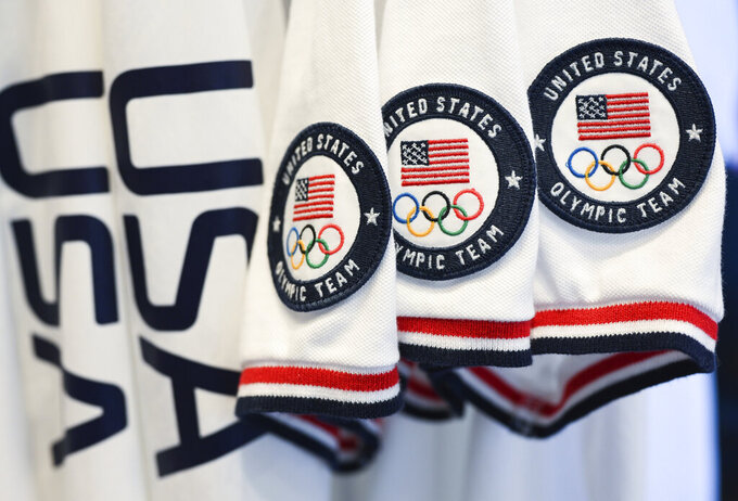 Team USA Tokyo Olympic closing ceremony uniforms are displayed during the unveiling at the Ralph Lauren SoHo Store on April 13, 2021, in New York. Ralph Lauren is an official outfitter of the 2021 U.S. Olympic Team. (Photo by Evan Agostini/Invision/AP)
