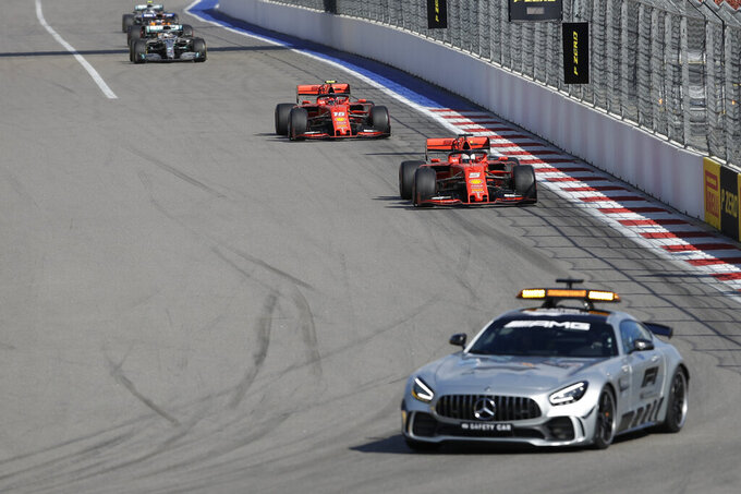 Safety Car drives ahead of Ferrari driver Sebastian Vettel of Germany, and Ferrari driver Charles Leclerc of Monaco during the Russian Formula one Grand Prix, at the 'Sochi Autodrom' Formula One circuit, in Sochi, Russia, Sunday, Sept. 29, 2019. (AP Photo/Luca Bruno)