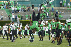 Marshall's Lawrence Papillon (4) does a backflip as Marshall players celebrate a win over No. 23 ranked Appalachian State after an NCAA college football game Saturday, Sept. 19, 2020, in Huntington, W.Va. (Sholten Singer/The Herald-Dispatch via AP)