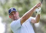 John Smoltz, former baseball pitcher, drives from the 2nd tee during during the final round of the Tournament of Champions LPGA golf tournament Sunday, Jan. 19, 2020, in Lake Buena Vista, Fla. (AP Photo/Gary McCullough)