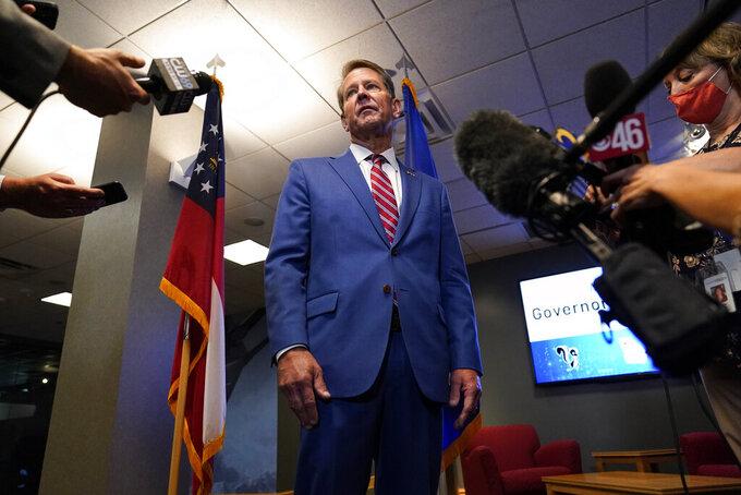 Georgia Gov. Brian Kemp speaks during a news conference at Lockheed Martin on Thursday, Aug. 26, 2021, in Marietta, Ga. (AP Photo/Brynn Anderson)