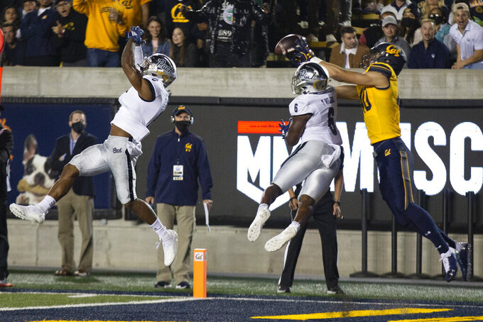 Nevada defensive back Berdale Robins (0) and Nevada cornerback Tyson Williams (6) break up a pass to the end zone intended for California tight end Keleki Latu (40) during the fourth quarter of an NCAA college football game, Saturday, Sept. 4, 2021, in Berkeley, Calif. (AP Photo/D. Ross Cameron)