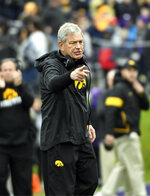 Iowa head coach Kirk Ferentz gestures to his team during the first half of an NCAA college football game against Northwestern, Saturday, Oct. 26, 2019, in Evanston, Ill. (AP Photo/David Banks)
