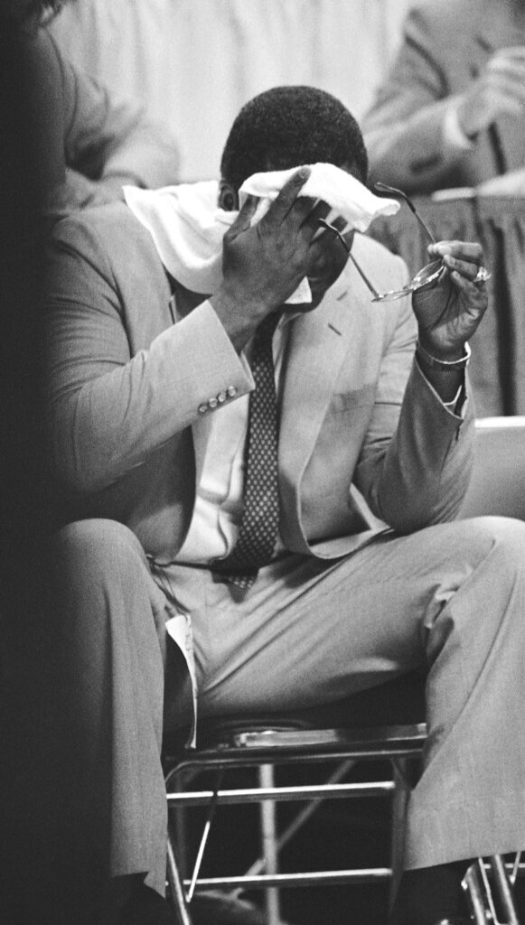 FILE - In this April 1, 1985, file photo, Georgetown coach John Thompson wipes his brow during the closing minutes of the college basketball NCAA Final Four championship game  against Villanova, in Lexington, Ky. Underdog Villanova, shooting 79 percent from the field, denied Patrick Ewing and top-ranked Georgetown a second straight NCAA basketball title with a 66-64 victory. (AP Photo/John Swart, File)