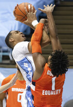 North Carolina's Garrison Brooks (15) muscles his way to the basket against Syracuse's Quincy Guerrier (1) during the first half of an NCAA college basketball game Tuesday, Jan. 12, 2021, in Chapel Hill, NC. (Robert Willett/The News & Observer via AP)