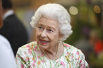 Britain's Queen Elizabeth II attends an event in celebration of 'The Big Lunch 'initiative, during the G7 summit in Cornwall, England, Friday June 11, 2021. (Oli Scarff/Pool Photo via AP)
