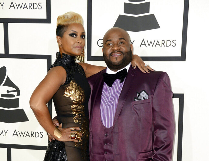 """FILE - This Jan. 26, 2014 file photo shows songwriter LaShawn Daniels, right, and his wife April Daniels at the 56th annual Grammy Awards in Los Angeles. LaShawn Daniels, a Grammy Award-winning songwriter who penned songs for Beyoncé, Whitney Houston and Lady Gaga died, Tuesday, Sept. 3, 2019, in a fatal car accident in South Carolina. He was 41. He earned a Grammy in 2001 for his songwriting work on Destiny Child's """"Say My Name."""" (Photo by Jordan Strauss/Invision/AP, File)"""