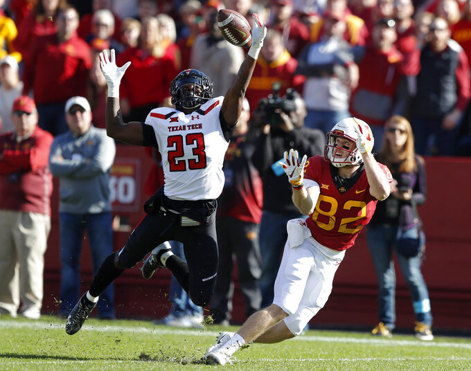 Texas Tech defensive back Damarcus Fields (23) breaks up a pass intended for Iowa State wide receiver Landen Akers during the first half of an NCAA college football game, Saturday, Oct. 27, 2018, in Ames, Iowa. (AP Photo/Charlie Neibergall)