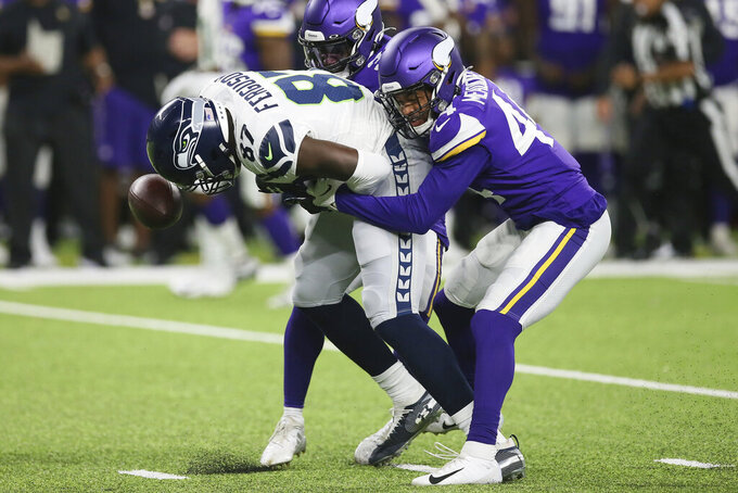 Seattle Seahawks wide receiver Jazz Ferguson (87) fumbles the ball as he is hit by Minnesota Vikings defensive back Nathan Meadors, right, during the second half of an NFL preseason football game, Sunday, Aug. 18, 2019, in Minneapolis. (AP Photo/Jim Mone)
