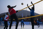 Brazil's Giba, right, tries to block Austria's Stefanie Schwaiger during a snow volleyball exhibition match at the Austria House in Pyeongchang, South Korea, Wednesday, Feb. 14, 2018. Europe has a small snow volleyball league, and promoters showed off the sport in an exhibition match before hundreds of curiosity seekers. (AP Photo/Felipe Dana)