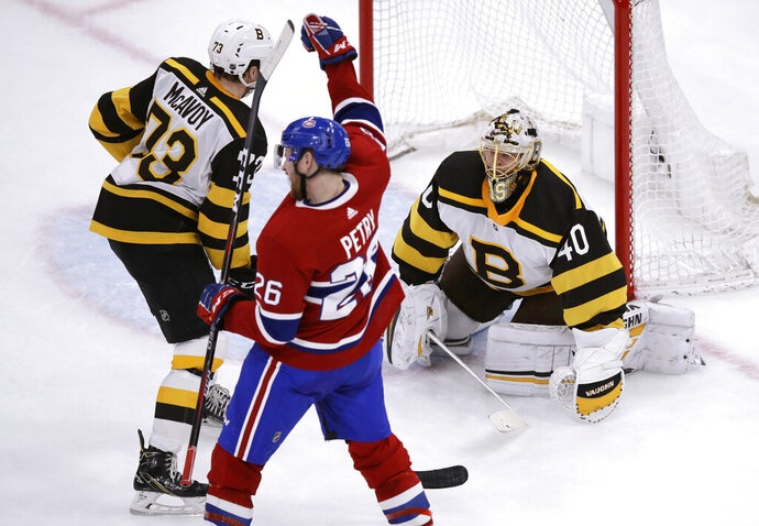 Montreal Canadiens defenseman Jeff Petry (26) raises his fist after beating Boston Bruins goaltender Tuukka Rask (40) on the game-winning goal during an overtime period of an NHL hockey game in Boston, Monday, Jan. 14, 2019. The Canadiens defeated the Bruins 3-2. At left is Boston Bruins defenseman Charlie McAvoy (73). (AP Photo/Charles Krupa)