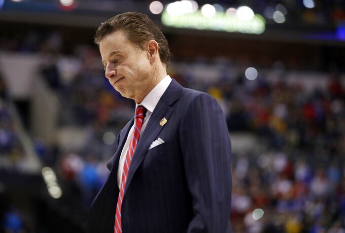 "FILE - In this March 19, 2017, file photo, Louisville coach Rick Pitino walks off the court after the team's 73-69 loss to Michigan in a second-round game in the men's NCAA college basketball tournament in Indianapolis.  A woman who had sex with coach Pitino at a restaurant was later jailed for trying to blackmail the coach to keep the tryst secret. A former escort wrote a book describing parties for recruits that included prostitutes; the team had its 2013 national title vacated because of that. And yet, Pitino didn't lose his job until the FBI investigation found that Louisville had paid a recruit's family $100,000--an allegation that Pitino said he was ""shocked"" to hear. He denies any wrongdoing. (AP Photo/Jeff Roberson, File)"