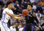 North Carolina's Cameron Johnson (13) passes against Washington's David Crisp (1) in the first half during a second-round men's college basketball game in the NCAA Tournament in Columbus, Ohio, Sunday, March 24, 2019. (AP Photo/John Minchillo)