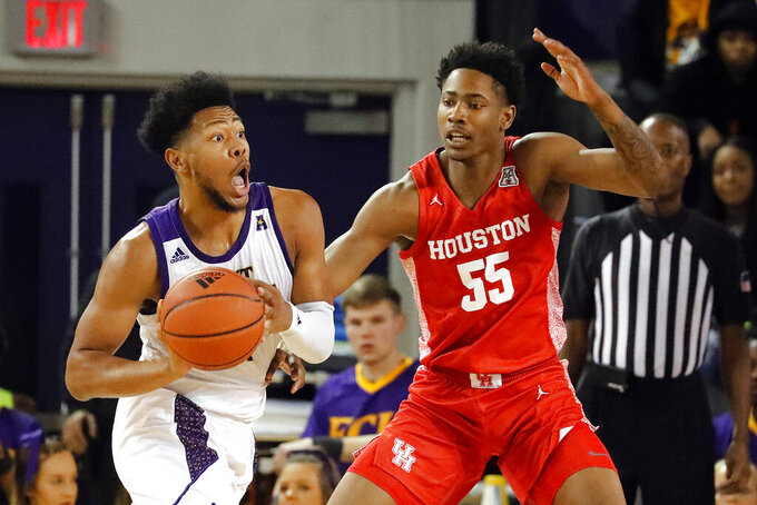 East Carolina's Jayden Gardner looks to pass the ball while defended by Houston's Brison Gresham (55) during the first half of an NCAA college basketball game in Greenville, N.C., Wednesday, Jan. 29, 2020. (AP Photo/Karl B DeBlaker)