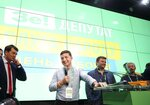Ukrainian President Volodymyr Zelenskiy, center, smiles while speaking to the media at his party's headquarters after a parliamentary election in Kiev, Ukraine, Sunday, July 21, 2019. Zelenskiy's party took the largest share of votes in the country's snap parliamentary election, an exit poll showed Sunday. (AP Photo/Evgeniy Maloletka)