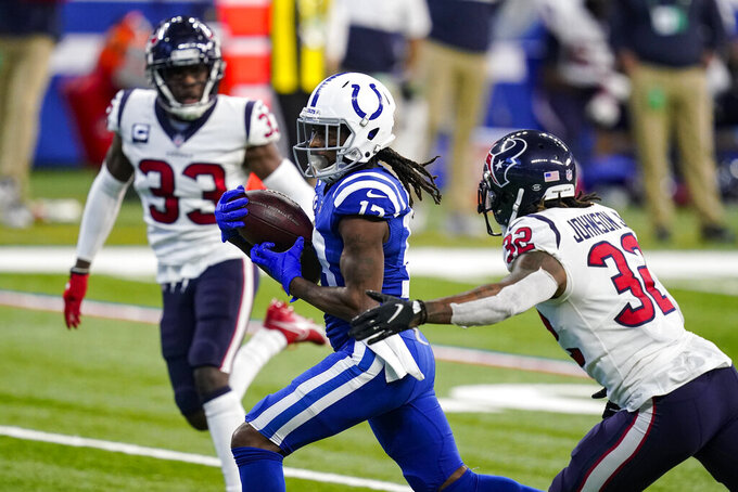 Indianapolis Colts wide receiver T.Y. Hilton (13) makes a catch for 41-yards in front of Houston Texans corner back Lonnie Johnson Jr (32) in the second half of an NFL football game in Indianapolis, Sunday, Dec. 20, 2020. (AP Photo/Darron Cummings)