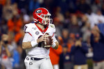 Georgia quarterback Jake Fromm (11) looks to pass during the second half of an NCAA college football game against Auburn, Saturday, Nov. 16, 2019, in Auburn, Ala. (AP Photo/Butch Dill)