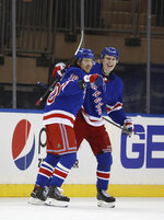 New York Rangers' Artemi Panarin (10) celebrates his goal with Brendan Smith during the third period of an NHL hockey game against the Washington Capitals Tuesday, March 30, 2021, in New York. (Al Bello/Pool Photo via AP)