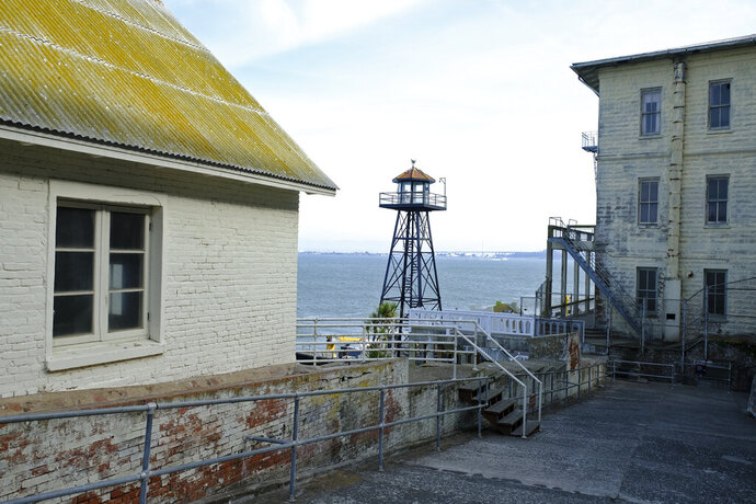 In this photo taken Tuesday, Nov. 12, 2019, a guard tower stands near the main dock on Alcatraz Island in San Francisco. The week of Nov. 18, 2019, marks 50 years since the beginning of a months-long Native American occupation at Alcatraz Island in the San Francisco Bay. The demonstration by dozens of tribal members had lasting effects for tribes, raising awareness of life on and off reservations, galvanizing activists and spurring a shift in federal policy toward self-determination. (AP Photo/Eric Risberg)