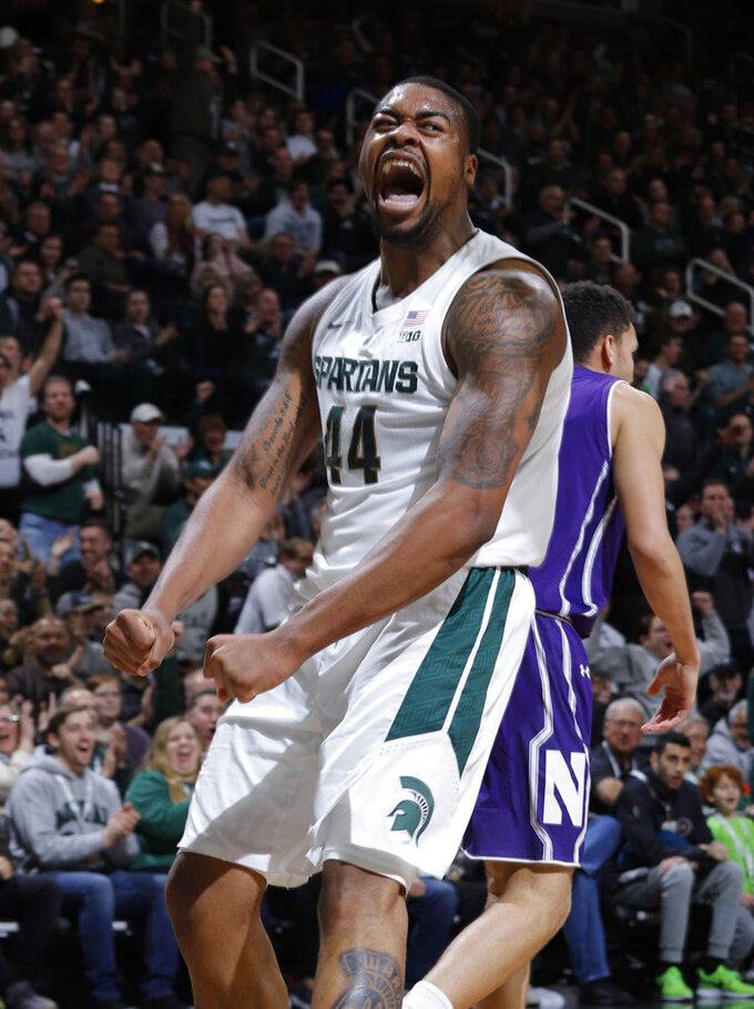 Michigan State's Nick Ward celebrates a play against Northwestern during the first half of an NCAA college basketball game, Wednesday, Jan. 2, 2019, in East Lansing, Mich. (AP Photo/Al Goldis)