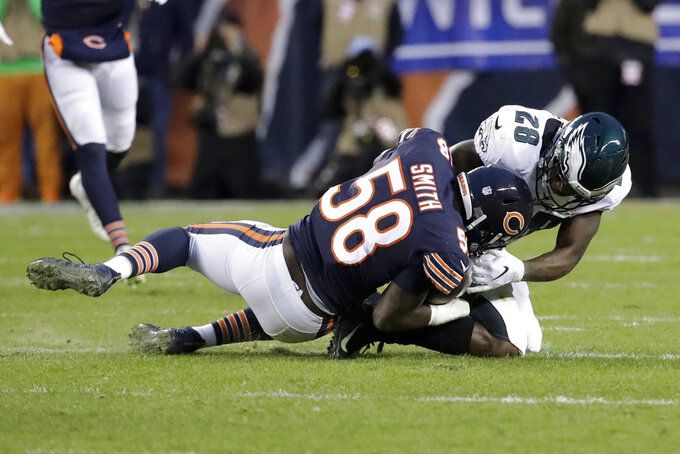 Chicago Bears linebacker Roquan Smith (58) intercepts a pass intended for Philadelphia Eagles running back Wendell Smallwood (28) during the first half of an NFL wild-card playoff football game Sunday, Jan. 6, 2019, in Chicago. (AP Photo/Nam Y. Huh)