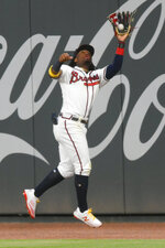 Atlanta Braves right fielder Ronald Acuna Jr. catches a fly ball off the bat of Miami Marlins' Brian Anderson to end a baseball game in the ninth inning, Monday, Sept. 21, 2020, in Atlanta. (AP Photo/John Amis)