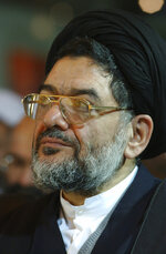 Ali Akbar Mohtashamipour listens to a speaker in a meeting in Tehran, Iran, on Dec. 4, 2003. Mohtashamipour, a Shiite cleric who as Iran's ambassador to Syria helped found the Lebanese militant group Hezbollah and lost his right hand to a book bombing reportedly carried out by Israel, died Monday, June 7, 2021, of the coronavirus. (AP Photo/Vahid Salemi)