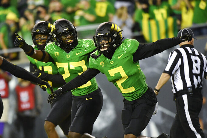 Oregon cornerback Mykael Wright (2) celebrates his interception with Oregon safety Verone McKinley III (23) during the first quarter of an NCAA college football game Saturday, Sept. 25, 2021, in Eugene, Ore. (AP Photo/Andy Nelson)