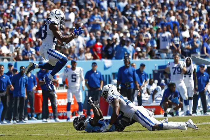 Indianapolis Colts cornerback Kenny Moore II (23) intercepts a pass intended for Tennessee Titans wide receiver Chester Rogers, on the ground, in the first half of an NFL football game Sunday, Sept. 26, 2021, in Nashville, Tenn. (AP Photo/Wade Payne)