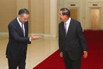 Chinese Foreign Minister Wang Yi, left, and Cambodian Prime Minister Hun Sen walk for a meeting at Peace Palace in Phnom Penh, Cambodia, Monday, Oct. 12, 2020. The two countries signed a free trade agreement on Monday. (AP Photo/Heng Sinith)
