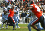 North Carolina's Nathan Elliott (11) launches a pass in the first half of an NCAA college football game against Virginia Saturday, Oct. 27, 2018, in Charlottesville, Va. (Zack Wajsgras /The Daily Progress via AP)