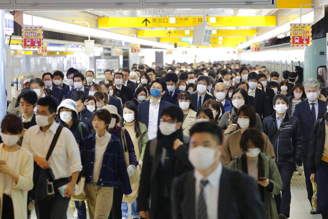 Commuters wear masks at a station in Fukuoka, southern Japan Wednesday morning, April 8, 2020. Japan's Prime Minister Shinzo Abe declared a month-long state of emergency Tuesday for Tokyo and six other prefectures including Fukuoka to ramp up defenses against the spread of the coronavirus as the number of infections surges. (Kyodo News via AP)
