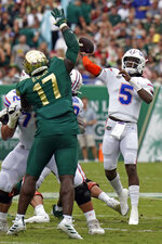 Florida quarterback Emory Jones (5) throws a touchdown pass over South Florida defensive tackle Blake Green (17) during the first half of an NCAA college football game Saturday, Sept. 11, 2021, in Tampa, Fla. (AP Photo/Chris O'Meara)