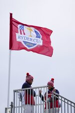 Fans wear hats as the wind blows during a practice day at the Ryder Cup at the Whistling Straits Golf Course Thursday, Sept. 23, 2021, in Sheboygan, Wis. (AP Photo/Jeff Roberson)