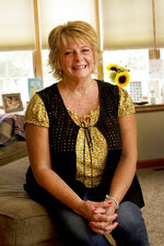 Kay Orzechowicz poses Wednesday, Sept. 2, 2020, for a portrait at her Griffith, Ind., home. After 35 years of teaching, Orzechowicz said COVID-19
