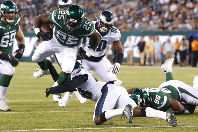 Philadelphia Eagles' Josh Hawkins, center bottom, tackles New York Jets' Elijah McGuire (25) during the first half of a preseason NFL football game Thursday, Aug. 29, 2019, in East Rutherford, N.J. (AP Photo/Jim McIsaac)