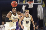 Liberty forward Myo Baxter-Bell, left, chases after ball during the first half against Lipscomb in the Atlantic Sun conference NCAA basketball championship game in Lynchburg, Va., Sunday, March 8, 2020. (AP Photo/Lee Luther Jr.)