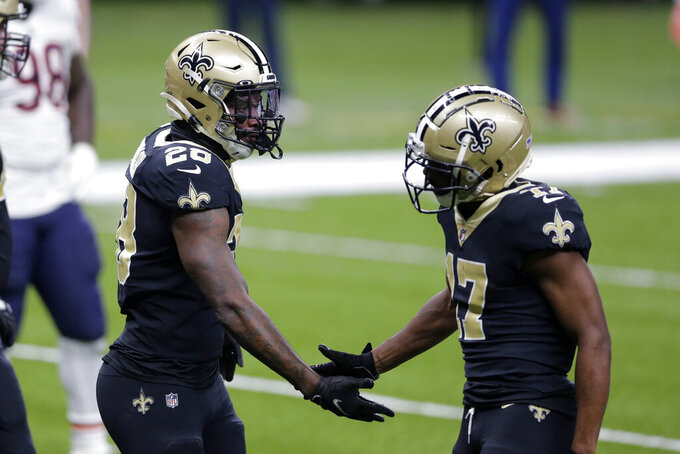 New Orleans Saints running back Latavius Murray (28) is congratulated by wide receiver Emmanuel Sanders (17) after his touchdown reception in the second half of an NFL wild-card playoff football game against the Chicago Bears in New Orleans, Sunday, Jan. 10, 2021. (AP Photo/Brett Duke)
