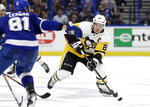 Pittsburgh Penguins center Sidney Crosby (87) moves the puck toward Tampa Bay Lightning defenseman Erik Cernak (81) during the first period of an NHL hockey game Wednesday, Oct. 23, 2019, in Tampa, Fla. (AP Photo/Chris O'Meara)